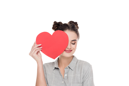 girl covering eye with red paper heart isolated on white, valentines day concept Stock Photo