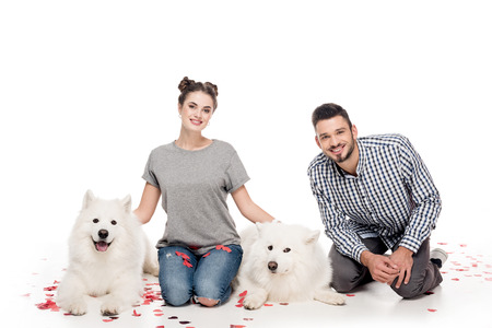 couple with dogs and heart shaped confetti on white, valentines day concept 版權商用圖片