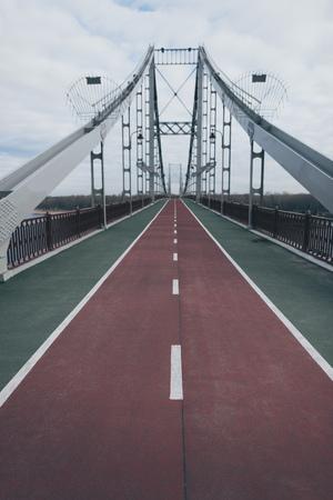 empty pedestrian bridge on cloudy autumn day