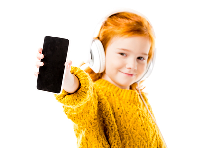 red hair kid showing smartphone isolated on white Stock Photo