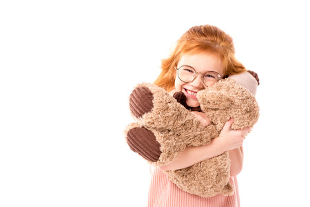 red hair kid hugging teddy bear isolated on white Stock Photo - 104549438