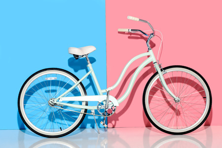 View of city bike on pink and blue background