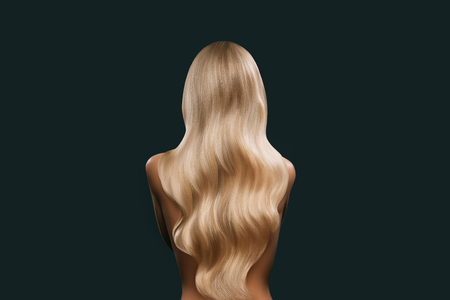 back view of girl with beautiful long blonde hair isolated on black