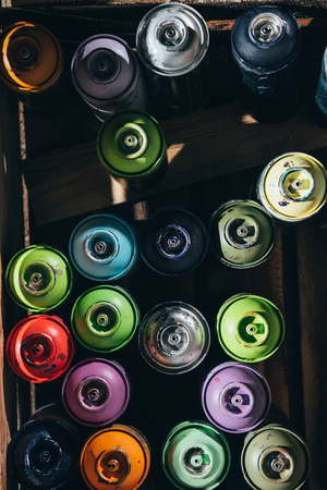 top view of cans with colorful aerosol paint 스톡 콘텐츠