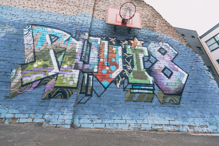 colorful graffiti on wall with basketball hoop Stock Photo