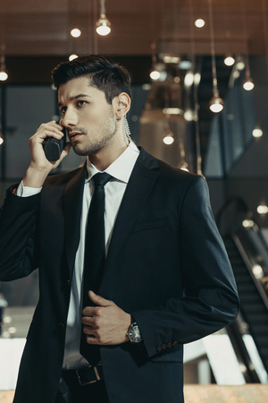 handsome security guard talking by portable radio in business center