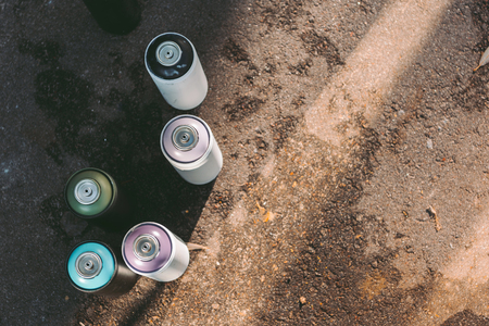 top view of aerosol paint for graffiti on asphalt Stock Photo