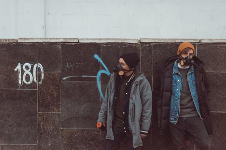 street artists in respirators standing at building 写真素材