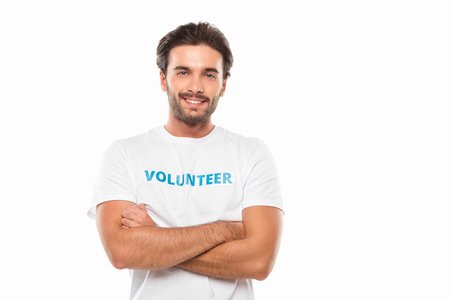handsome young volunteer showing thumb up isolated on white Standard-Bild - 104555965