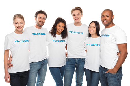 multiethnic group of embracing volunteers looking at camera isolated on white Standard-Bild - 104556060