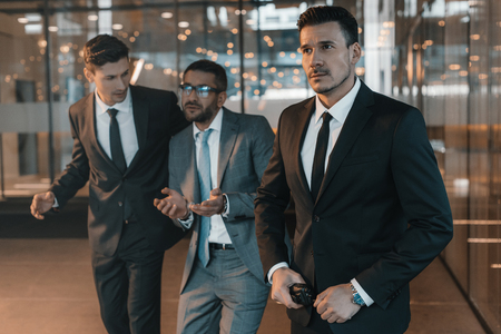 two security guards going with criminal in business center Stock Photo