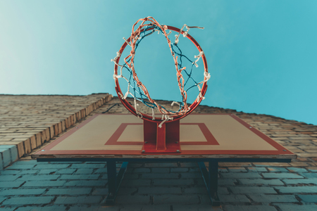 bottom view of basketball hoop on wall with graffiti Stock Photo