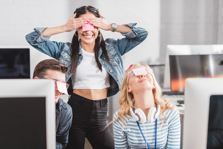 happy people with stickers on eyes in modern office Stok Fotoğraf - 104556877