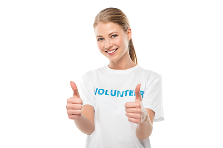 happy female volunteer showing thumbs up isolated on white