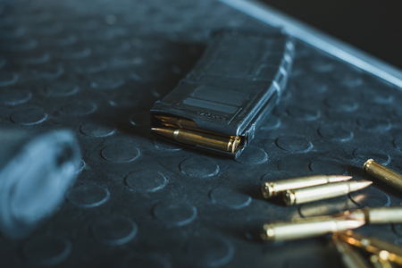 close up view of bullets and rifle magazine on table
