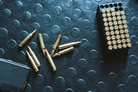 top view of rifle bullets and magazine on table