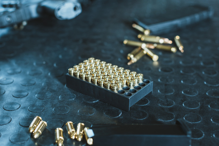 gun and rifle magazines with bullets on table