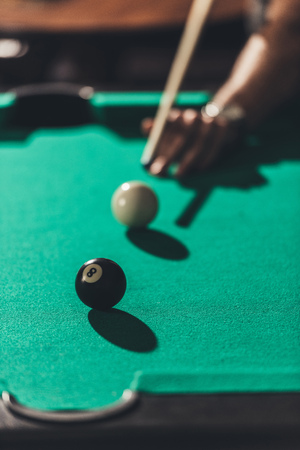 cropped image of man playing in pool Stock Photo