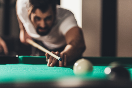 handsome caucasian man playing in pool