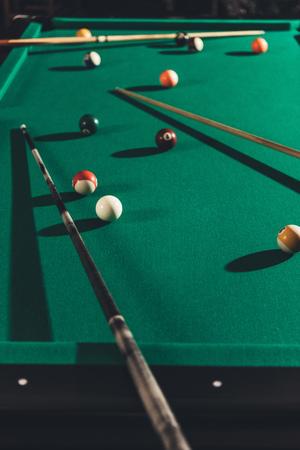 billiard gambling table with cues and balls Archivio Fotografico