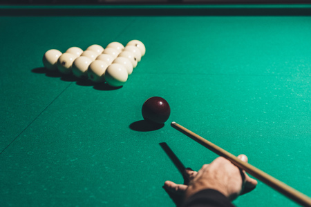 cropped image of male playing in russian pool Stock Photo