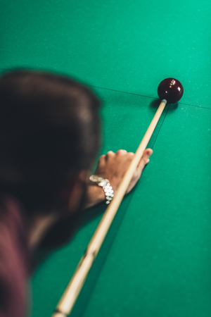 back view of cropped man playing in russian pool Stock Photo