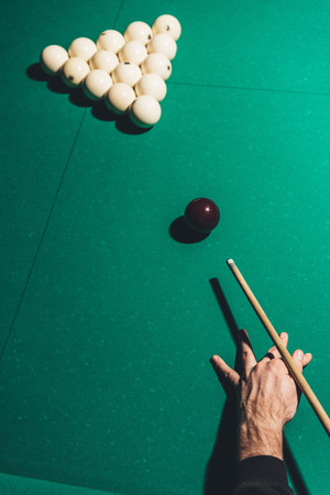 cropped image of male playing in russian pool 스톡 콘텐츠