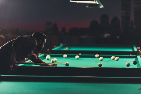 side view of man playing in russian pool at bar Archivio Fotografico