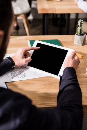 cropped image of businessman holding tablet in hands