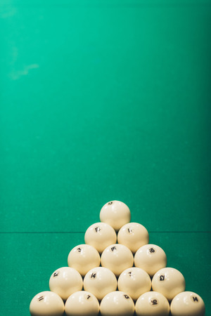 green gambling table with balls for russian pool