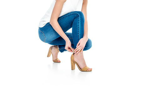 cropped view of stylish woman wearing heels, isolated on white Standard-Bild - 104562690