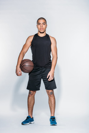 african american basketball player standing with ball Stockfoto