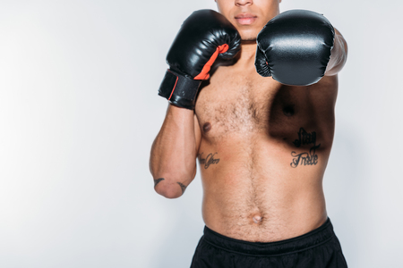 cropped image of african american man boxing on white