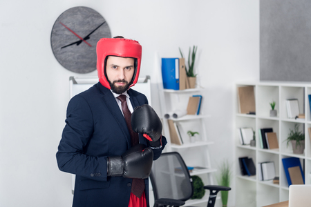 portrait of young businessman in boxing equipment in office Stok Fotoğraf