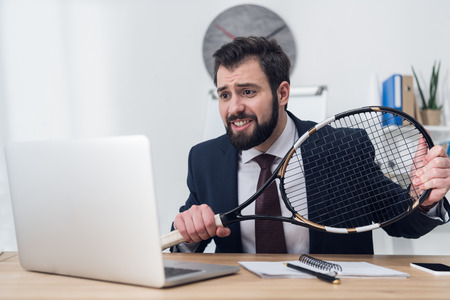 businessman in suit with tennis racket at workplace Stok Fotoğraf
