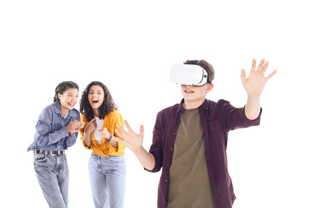 laughing teenage students having fun with vr headset isolated on white Banco de Imagens