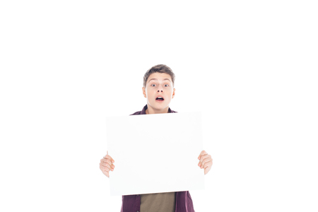 portrait of shocked teenager with empty banner in hands isolated on white