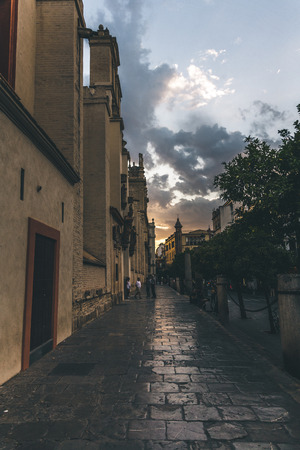 street view at evening time under beautiful cloudy sky, spain
