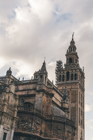 old gothic Seville Cathedral under cloudy sky, spain Stock Photo