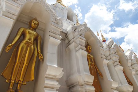 bottom view of beautiful golden buddha statues at thai temple