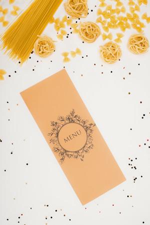 top view of decorative restaurant menu and raw pasta on white 版權商用圖片
