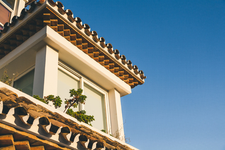 roof of spanish house under blue sky Banco de Imagens