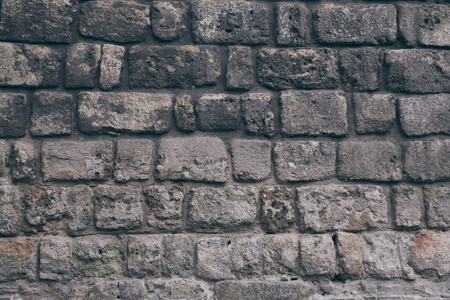 close-up shot of black aged brick wall for background 写真素材