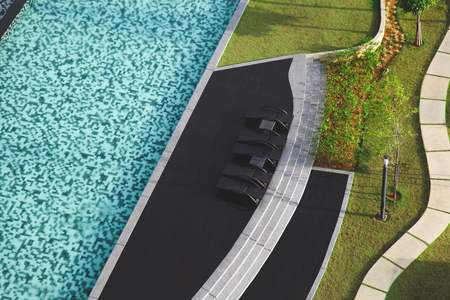 aerial view of swimming pool with sunbeds at hotel Stock Photo