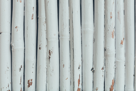 fence made of wooden logs painted in white for background Stok Fotoğraf