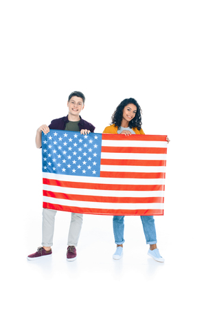 smiling teenage students with usa flag isolated on white 写真素材