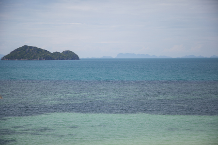 seascape with beautiful green island on cloudy day 写真素材