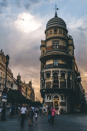 beautiful view of city street with people at evening time, spain Editorial