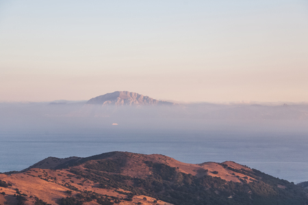scenic view of beautiful mountains landscape with sea and fog, spain 스톡 콘텐츠 - 104707288