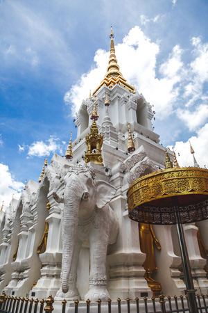 beautiful thai temple decorated with sculptures an gold